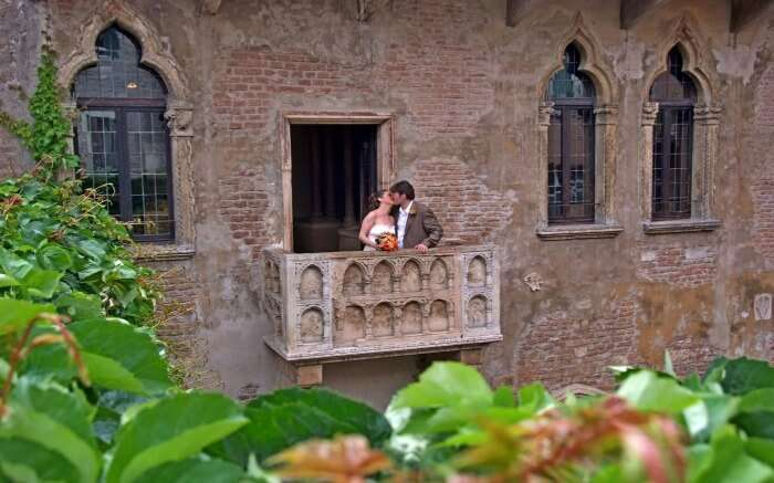 A couple in Juliet's Balcony