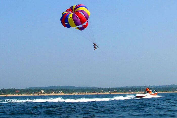 a guy parasailing over Arabian sea