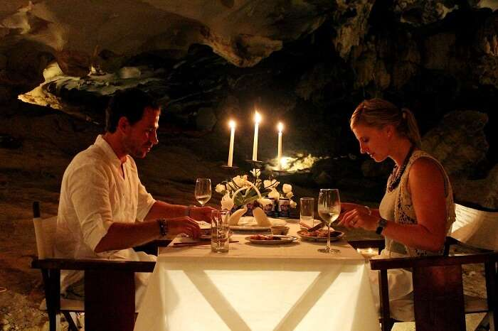 A couple enjoys a romantic dinner in the caves of Halong Bay