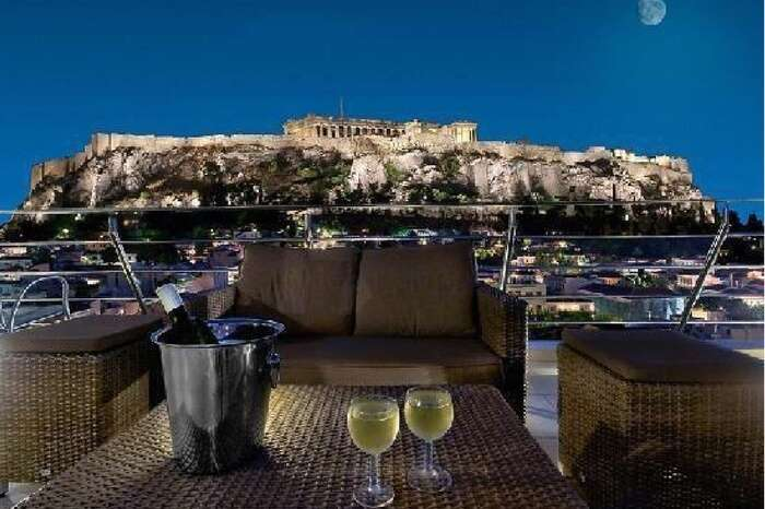 A beautiful dining setup overlooking Plaka in Greece at night