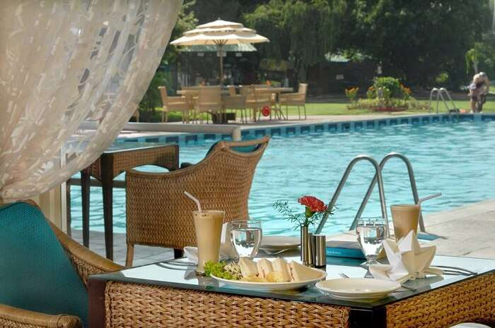 A shot of the poolside coffee lounge at the Country Club Resort near Gurgaon