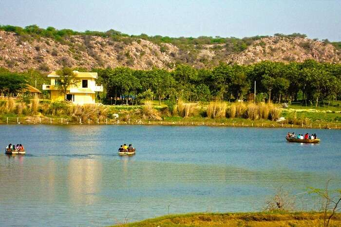Tourists boating in the Damdama Lake that is one of the weekend getaways near Gurgaon