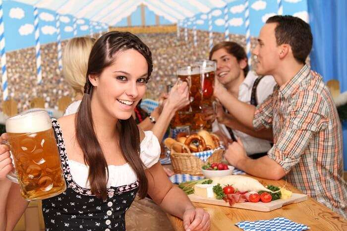 girl drinking beer at Oktoberfest in Germany