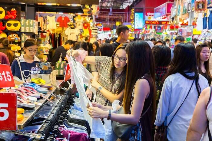 a girl shopping in Singapore flea market