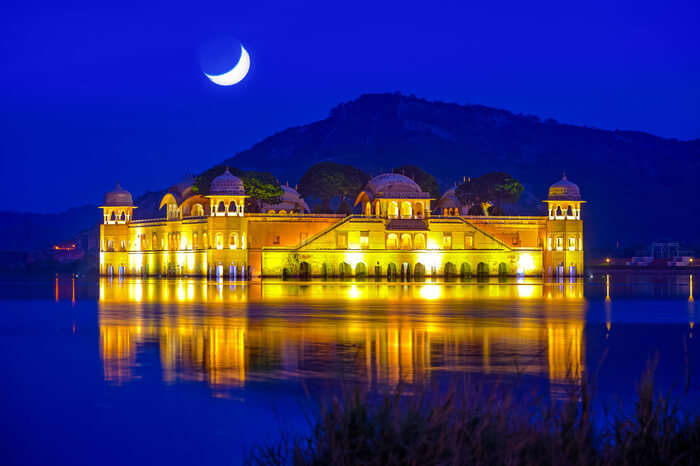 lake palace glowing at night