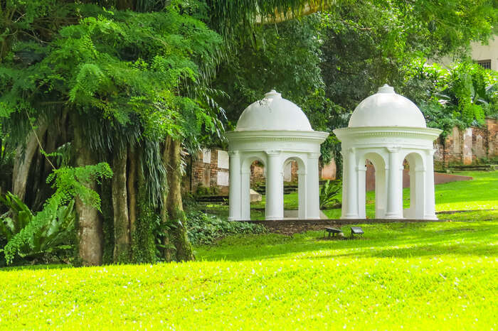 two white gazebos in a park