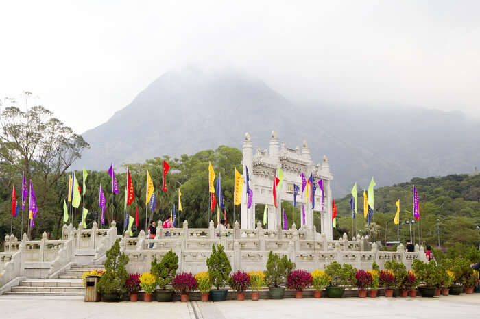 colourful flags at the entrance of Po Lin Monastery