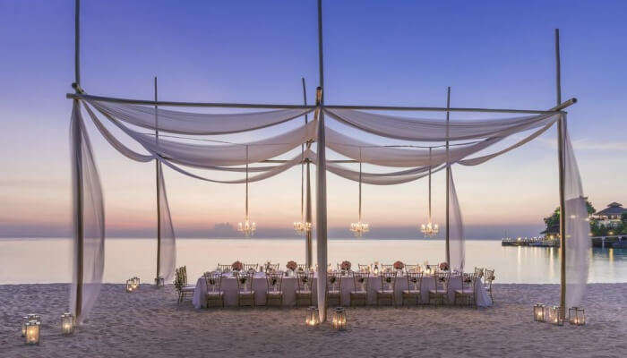 setting for wedding dinner on a beach