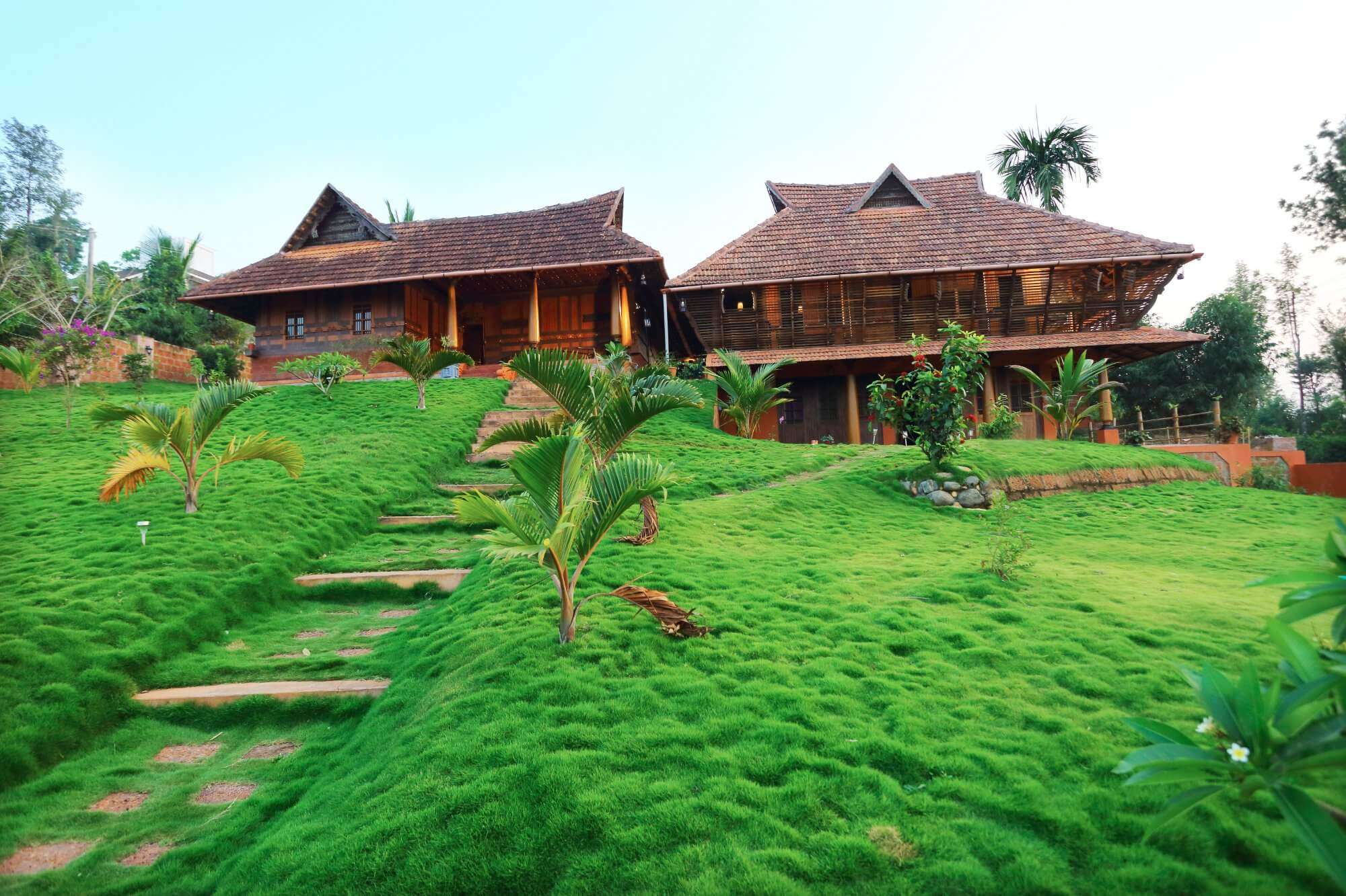 Luxury suites of Thejas Resort surrounded by lush greenery