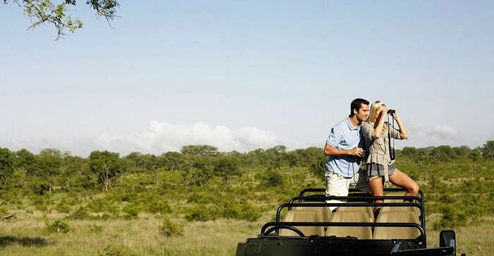 couple enjoying jeep safari on honeymoon in Namibia