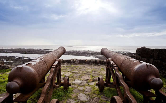 two canons facing the beach in Alibaug