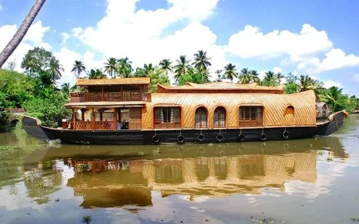 A view of Amrutham Houseboat sailing in the backwaters of Kumarakomss