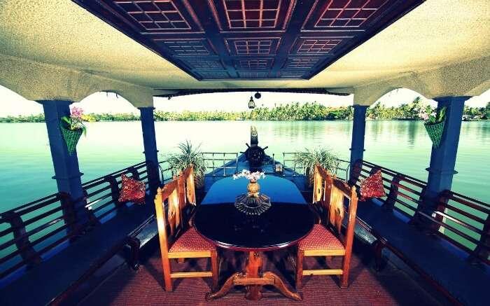 Dining area of Angel Queen Houseboats in Alleppey overlooking deck