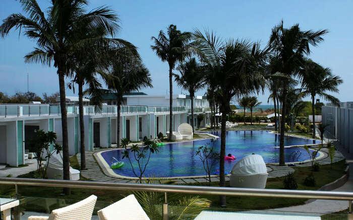 Dining area overlooking pool at L'attitude in Mahabalipuram in Chennai