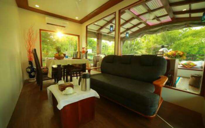 Dining space overlooking front deck of Nova Holidays Houseboat in Alleppey