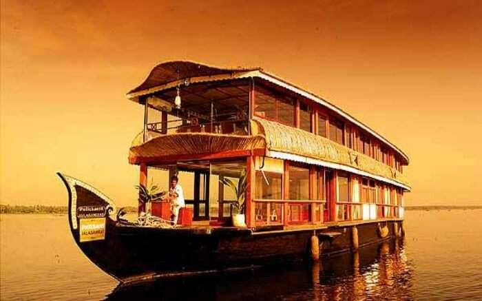 Front view of Pulickattil Houseboat on a bright day in Alleppey