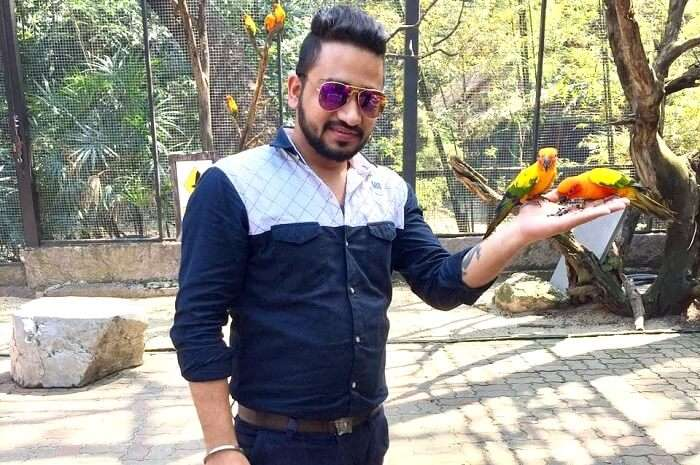 posing with parrots in safari world