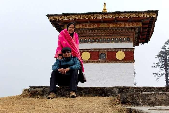 pradipranjan and his wife outside a monastery