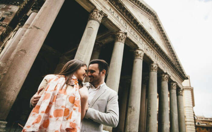 A couple in front of the Pantheon - one of the best places to visit a honeymoon in Rome