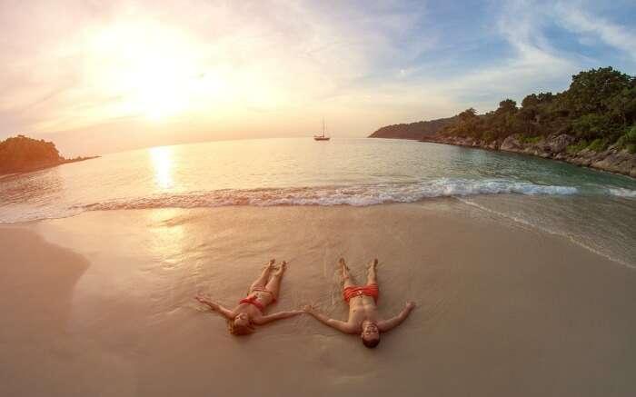 A couple on a beach in Thailand