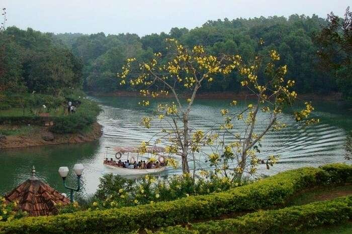 People boating in the water of Nisargadhama Islands