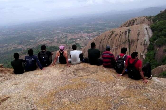 Group of friends sitting atop the hill in Savandurga near Bangalore