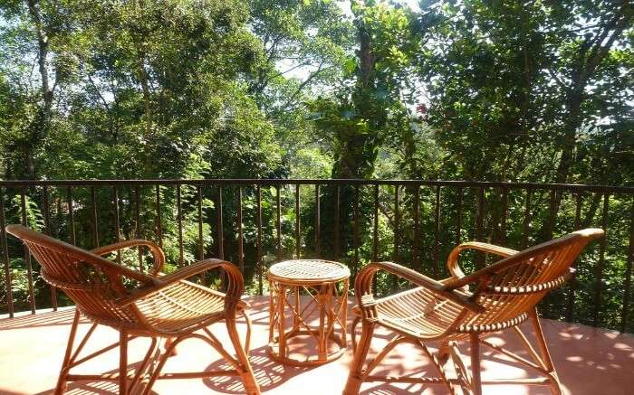 bamboo chairs and table in a balcony in Chrissies hotel in Thekkady ss25042017