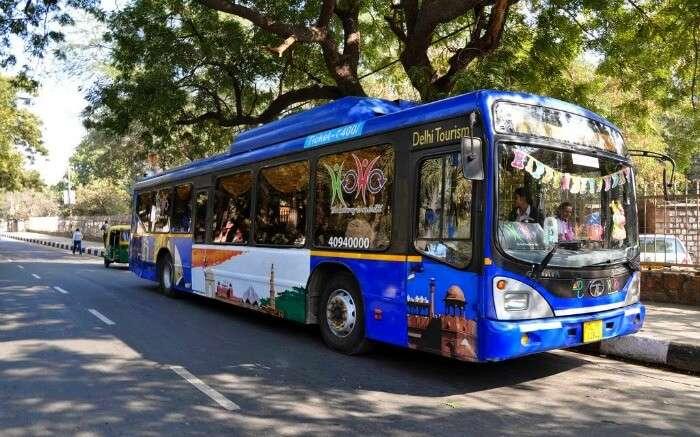 blue colour hoho bus on Delhi roadsSS13042017