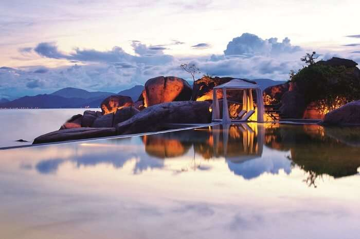 The infinity pool at the edge of the sea at L Ayana Beach Resort in Vietnam