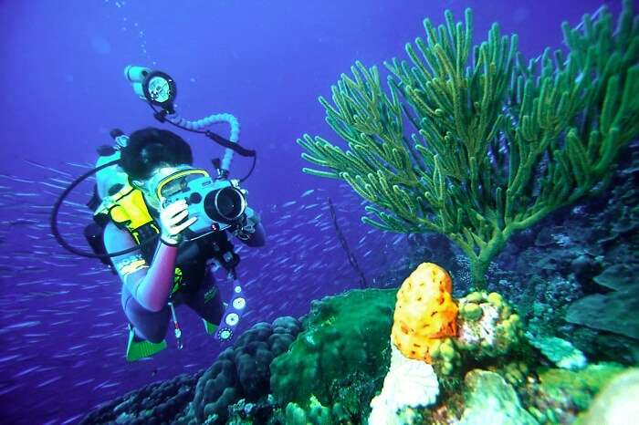 A tourist enjoys scuba diving in Sihanoukville in Cambodia in summer