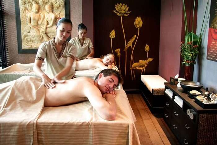 A couple enjoys massage therapies at Bodia Spa in Siem Reap
