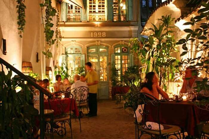 -People having dinner at the romantic Green Tangerine restaurant in Hanoi