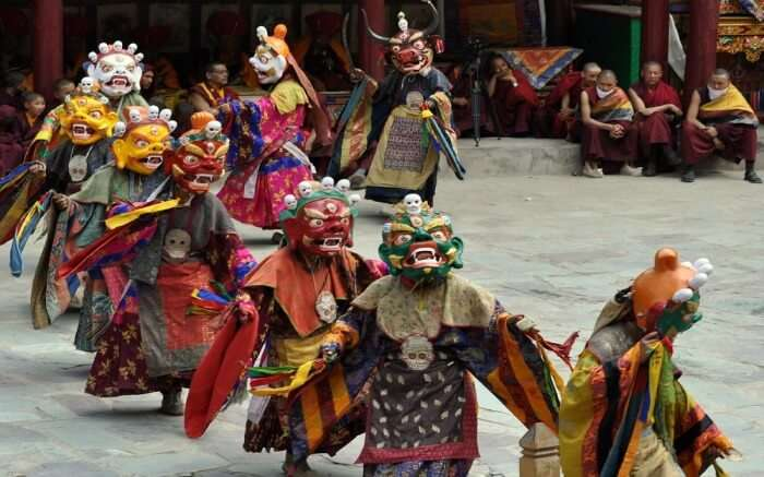 men wearing mask during Hemis festival in Ladakh