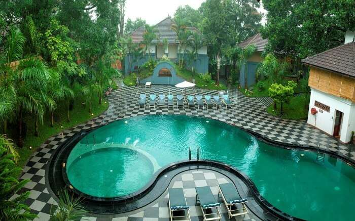 outdoor pool of the Elephant court hotel in Thekkady