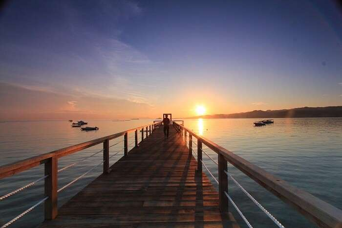 A beautiful shot of a sunset over the jetty on Gili Gede