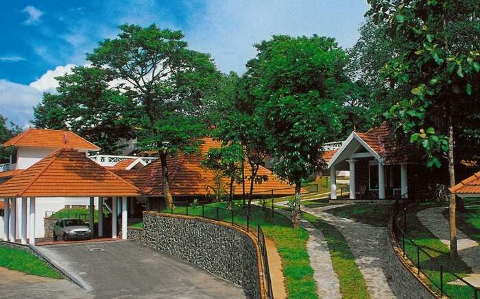 red and white painted bungalows of Hotel Treetop in Thekkady