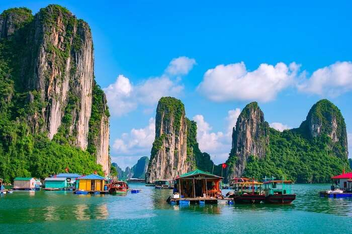 A beautiful snap of the floating fishing village and the rock island in Halong Bay