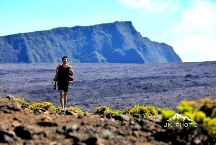 man hiking in Reunion Island, France