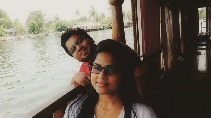 couple cruising on backwaters in Kerala