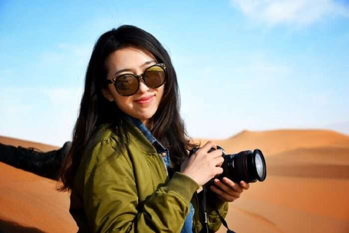 woman photographer mongolia desert