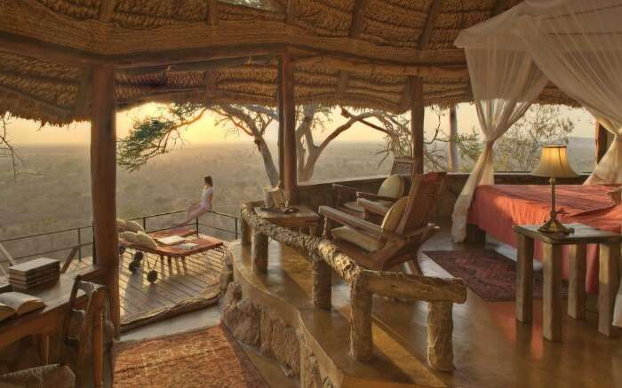 A woman enjoying nature view from a safari honeymoon resort