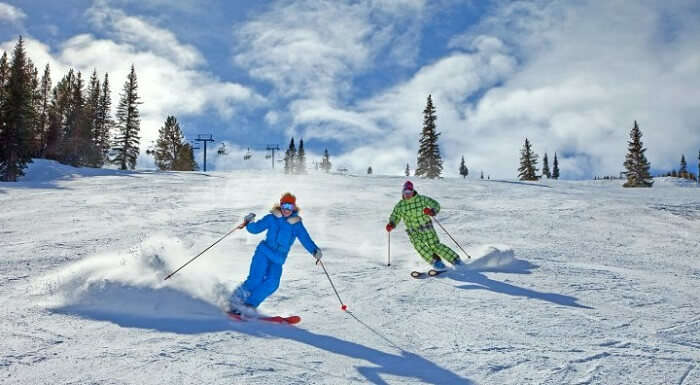 couple skiing in aspen