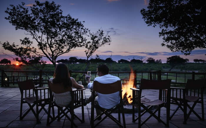 Couple enjoying a romantic evening outside Belmond Savute Elephant Camp in Botswana