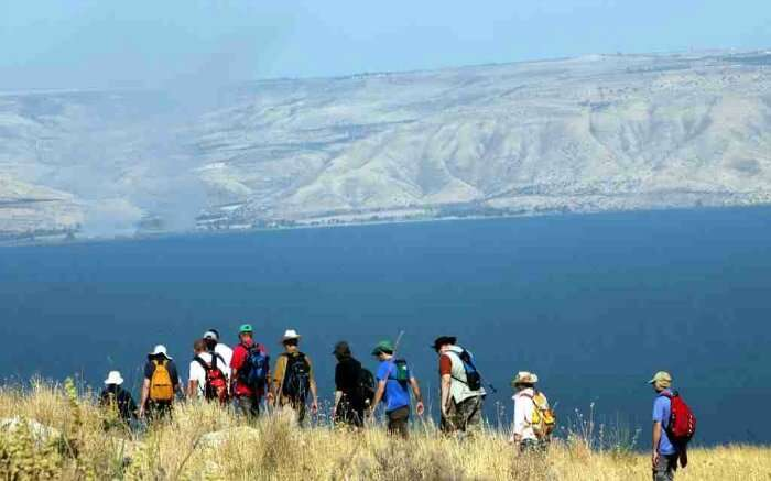 Hikers walking past Sea of Galilee in Israel