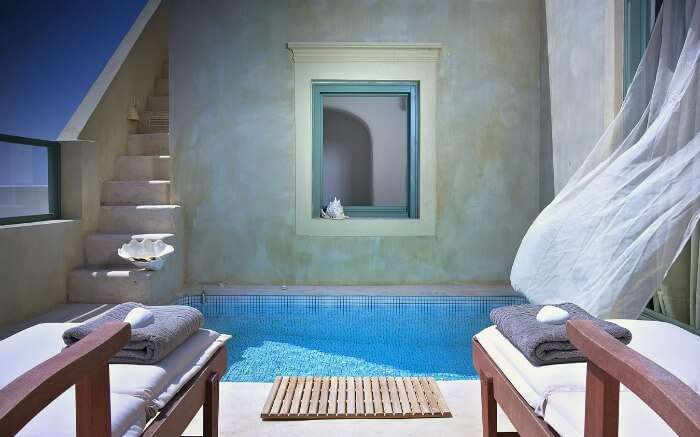 Interior of luxurious Villa Estella room with a pool in balcony