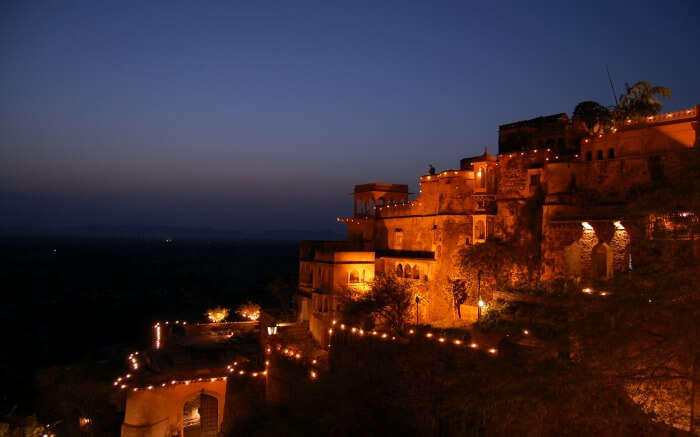 Neemrana Fort Palace lit up in evening
