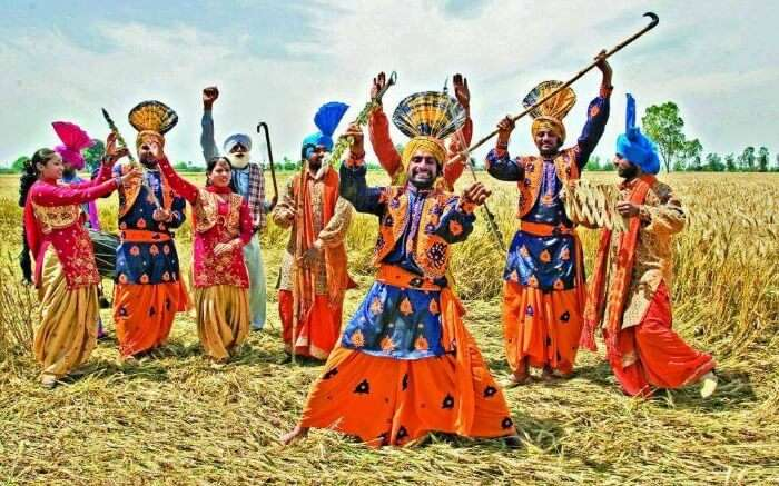Punjabi men and women dancing during Baisakhi