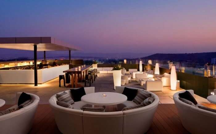 Rooftop dining and bar of Paasha JW Marriott House overlooking the city