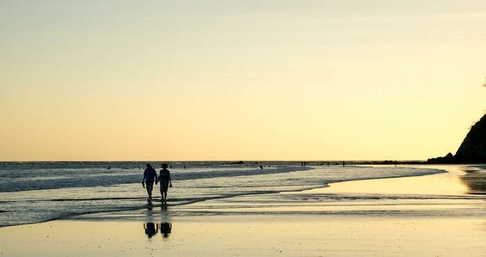 couple walking on samara beach