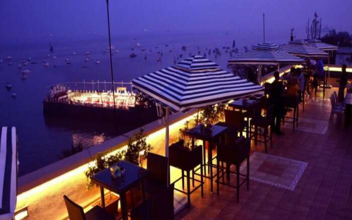 Well lit dining space of The marina Upper Deck in Colaba in Mumbai
